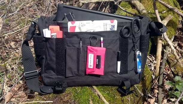 My EDC Bag Contents Computer Pistol Tourniquet Medical Supplies Knife Flashlight